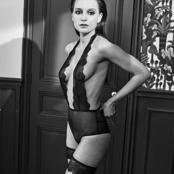 Open bodysuit in fishnet and black lace, plunging neckline and halter neckline, from the NOMMEE DESIR range by Atelier Amour at Brigade Mondaine