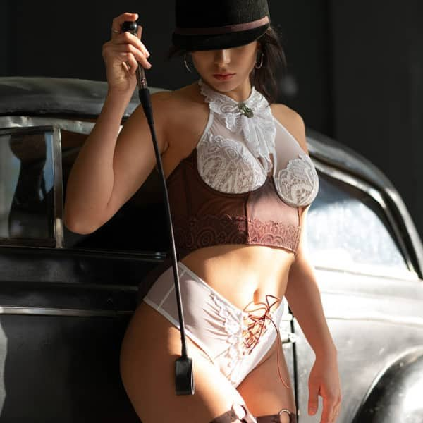 Rider roleplay costume with white thong and white and brown strapless bra with lace collar and brown garters BAED STORIS at Brigade Mondaine