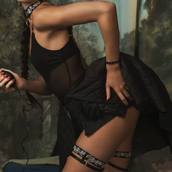 Black lingerie set with transparent mesh body, open panties and lace garters BORDELLE at Brigade Mondaine