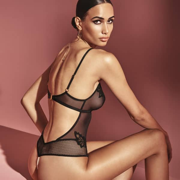 Halter bodysuit with g-string and stimulating multi-material pearls in mesh, lace and black fishnet BRACLI at Brigade Mondaine