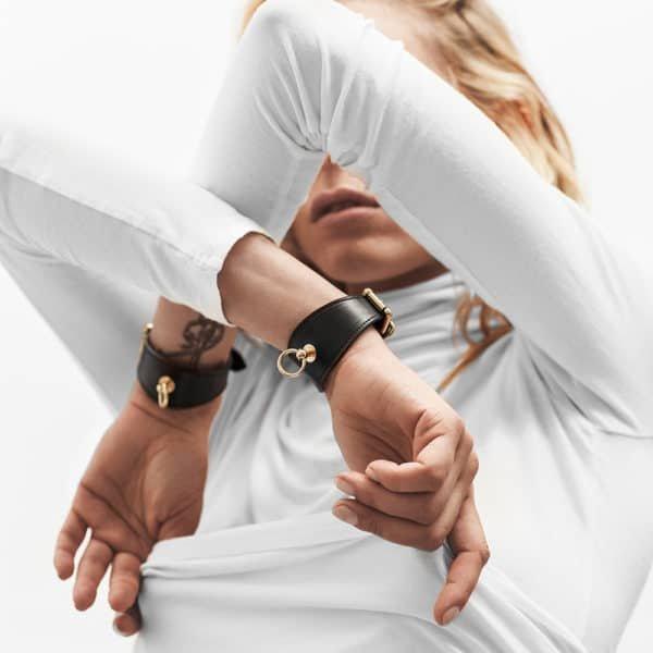 Black vegetal leather bdsm bracelet and ring d'fastened in the middle by Domestique at Brigade Mondaine