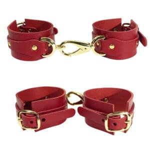 Red leather handcuffs with details and gold ELF ZHOU strap at Brigade Mondaine