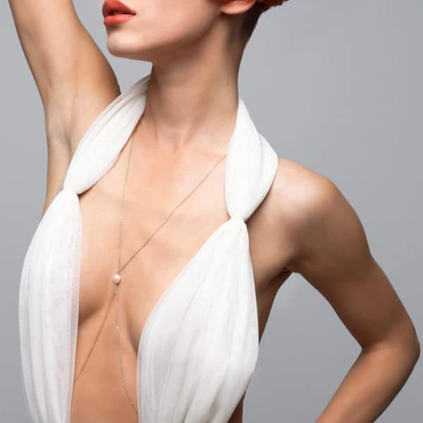 Handmade gold body jewelry with small pearl between the breasts and halter FUNGI at Brigade Mondaine