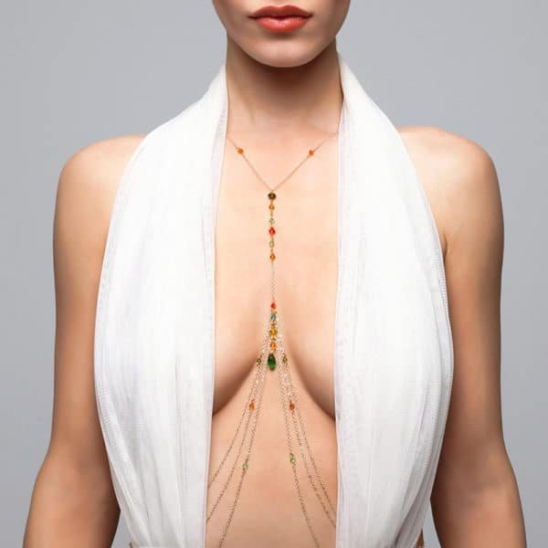 Body jewelry with pendant between the breasts and multicolored FUNGI crystals at Brigade Mondaine