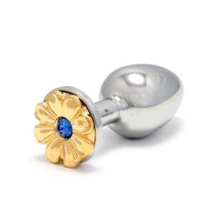 ROSEBUDS en Brigade Mondaine Daisy Blue Gold Plug en acero quirúrgico con patrón de flores doradas y cristal azul