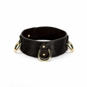 The Model Traitor 3D necklace in black leather and gold finishes at Brigade Mondaine