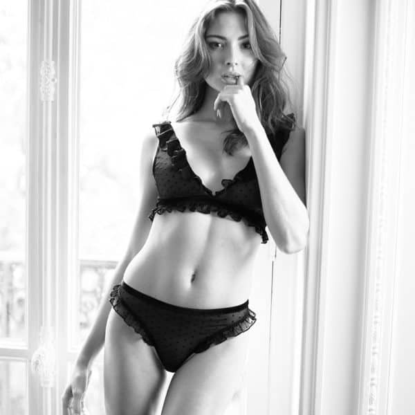 Black mesh thong with small patterns and ruffles on the top of the thighs ATELIER AMOUR at Brigade Mondaine