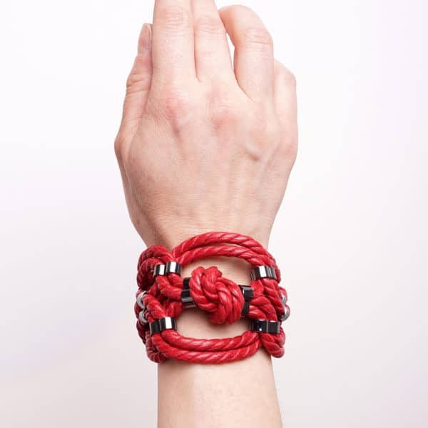 Red shibari bondage knotted rope bracelet with nickel-free metal detail Figure of A at Brigade Mondaine