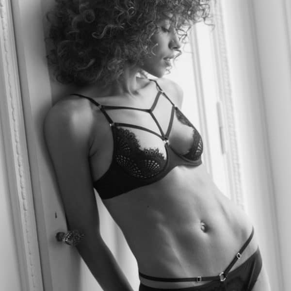 Round black lace lingerie set with half-open and crossed bra and open panties with flying lace Atelier Amour at Brigade Mondaine