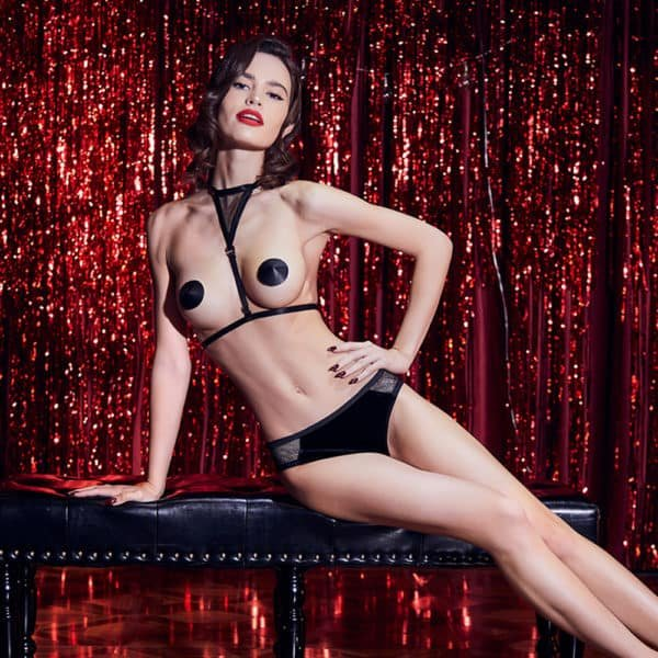 Black fishnet and velvet lingerie set with open panties and pompom on the buttocks and bust harness UPKO at Brigade Mondaine