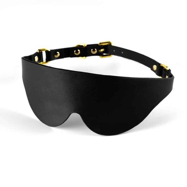 All black leather eye mask with UPKO gold finish at Brigade Mondaine