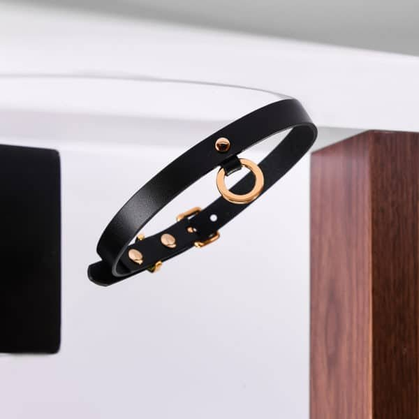 Fine black leather choker with 24K gold ring UPKO at Brigade Mondaine