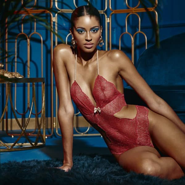 G-string bodystocking with stimulating pearls and red lace satin attachments SYDNEY collection with small bow on the front BRACLI at Brigade Mondaine