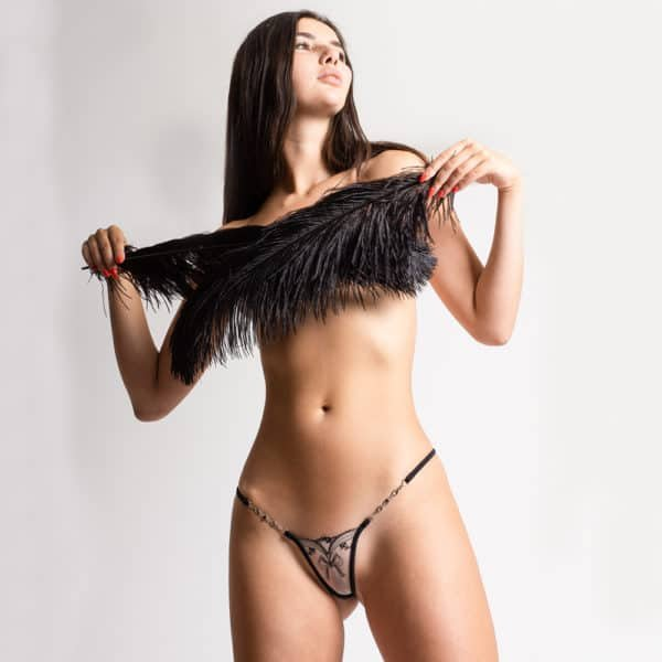 Silver jewel g-string made of flesh-colored mesh and black lace with Lucky Cheeks knot motif at Brigade Mondaine