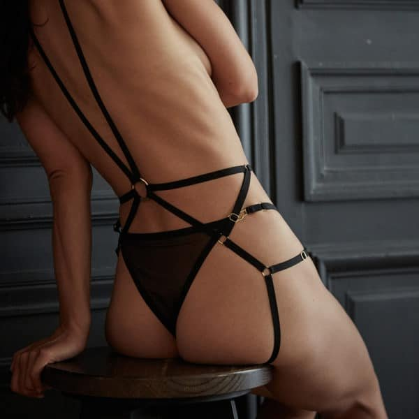 Harness set in fishnet and black elastics and high pants in tulle and black elastics back view made in France from the collection Insoutenable Légèreté d'Atelier Amour at Brigade Mondaine