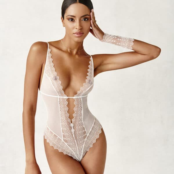 Ivory body in lace and real Majorcan pearls, neckline up to #039;in the middle of the belly, pearl glove sensation wrist from the BRACLI brand GENEVA collection at BRIGADE MONDAINE