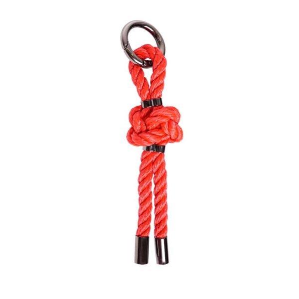 Llavero de Bdsm en la cuerda roja