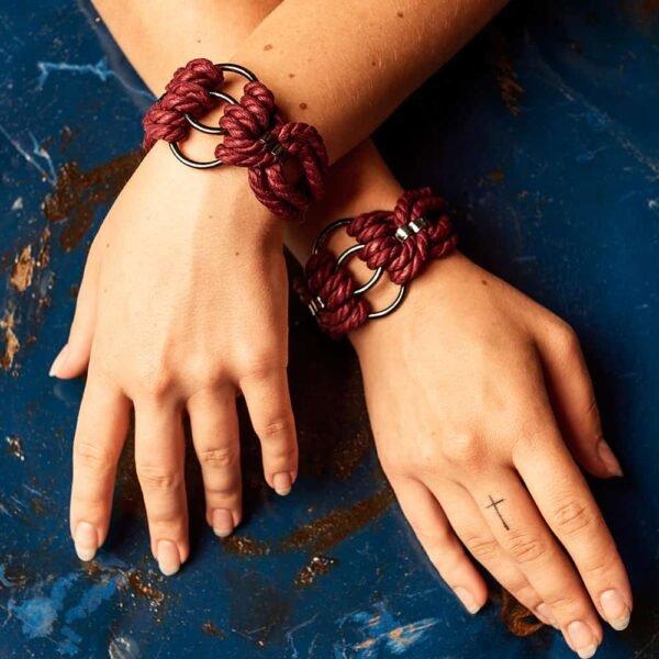 Bdsm bracelet in burgundy strings with silver details