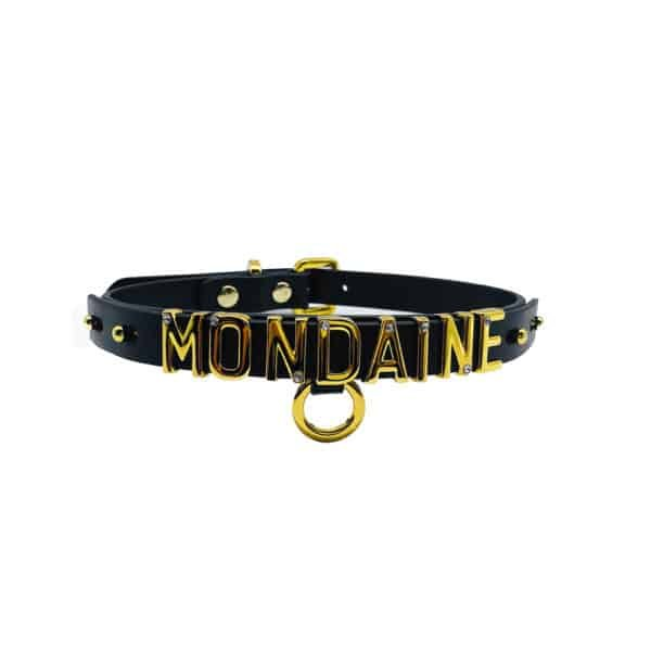 Necklace / choker in soft black Italian leather with 24 carat gold-plated hook and letters and a small stone inlaid on each of the letters writing the word WORLD from the UPKO X Brigade Mondaine collection available at Brigade Mondaine