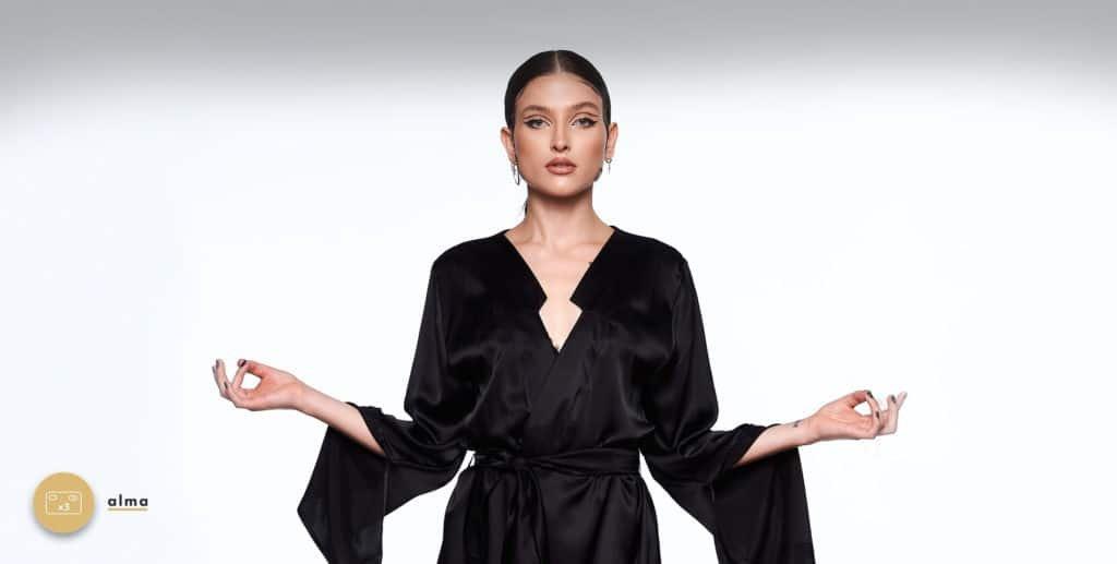 The model is wearing an item from the brand Ludique. Infinity Kimono dress, long black satin Kimono.