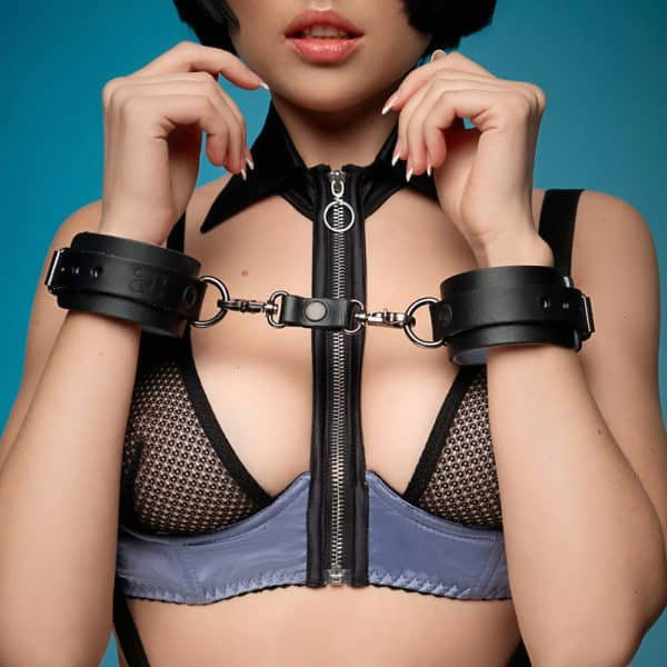 Black leather handcuffs with silver attachments and details with l'soft blue interior material
