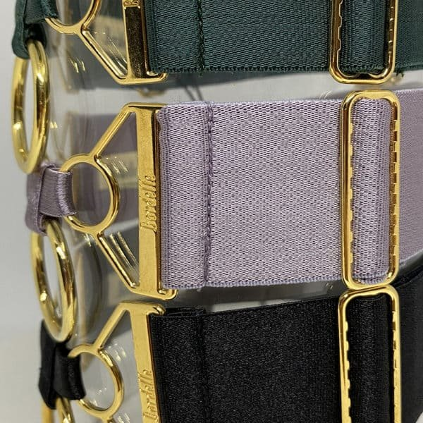 Necklace Straps Bordelle in Black Eden and Tundra, the product is made of satin elastic and gold plated. The necklace strap is wide, the elastic is topped with 24 carat gold plated finish details.