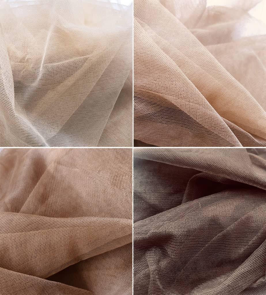 Розовая камея цветов, которая рисует на коричневом фоне движущейся ткани.