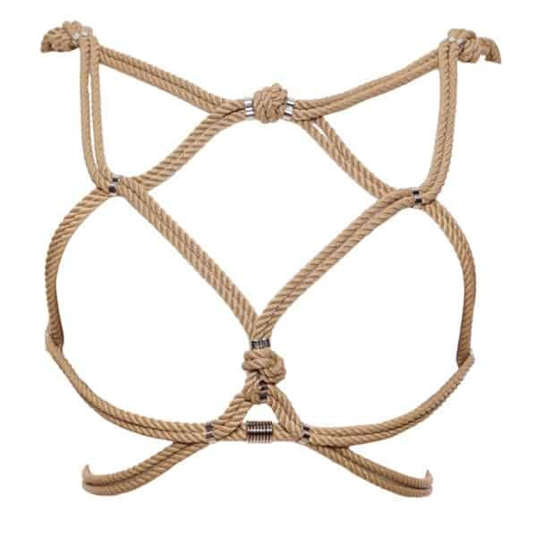 Hoshi harness from Figure of A in beige color. This piece is made from waxed cotton ropes and silver beads in zinc and brass alloy. It is worn over the ribcage and contains an interlacing of ropes that wrap around the breasts and waist.