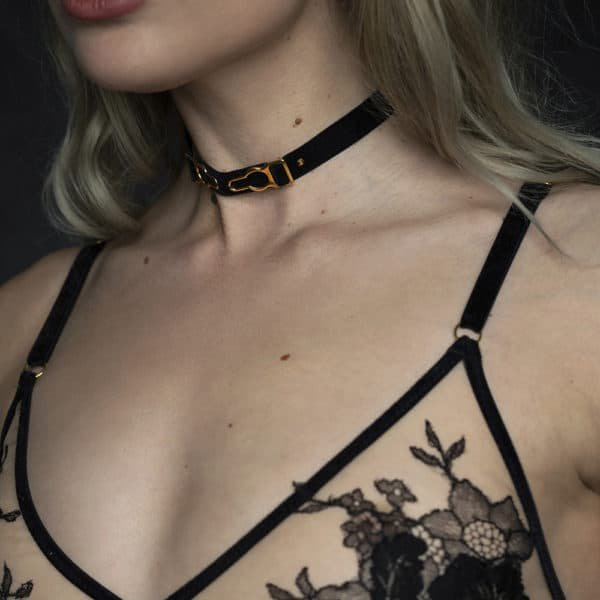Triangle bra and choker by HERVÉ by Céline Marie, shaped with black velvet elastics and a transparent fabric decorated with black lace. The clasps of the choker and the rings of the bra are golden.