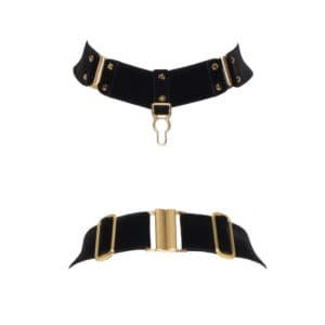 Black Verene necklace by Hervé by Celine Marie. This necklace is made from black elastic in thick soft velvet and 24 carat gold plated settings and hooks. A gold clasp is placed as a pendant, next to it are two hooks framed with nails. At the back, a clasp and settings are present.