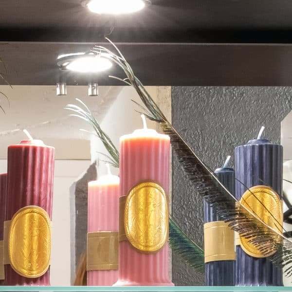 Upko x Brigade Mondaine candle pink, purple and red. The candles are in the shape of a Greek temple column.