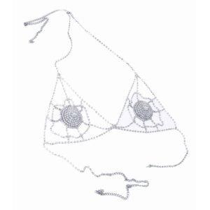 Это изделие представляет собой хрустальный бюстгальтер от ELF Zhou London. Она состоит из хрустальных накладок на соски. Каждая грудь украшена паутиной с кристаллами. Бюстгальтер застегивается на шее и сзади.