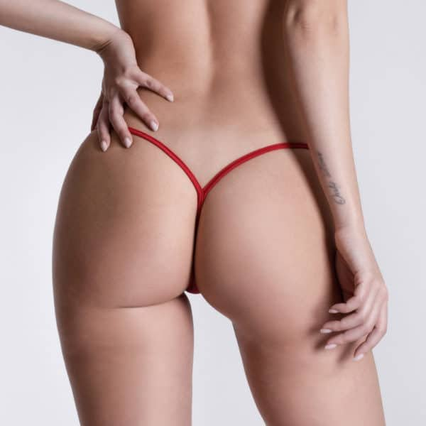 Here you can see Micro V thong Transparent Red from the brand LUCKY CHEEKS. Behind, the red bands of the hips meet.