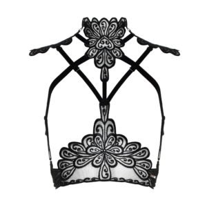 Black lace harness from the brand Asche & Gold. At the top, there are small transparent parts on each side and black lace seams in the center. Also, there is a thin black band that crosses the breasts and crosses below.