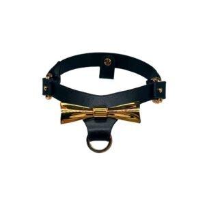 Chocker noir et or de la marque Upko avec au centre un noeud couleur or.